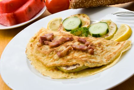 breakfast with fried eggs-omelet,and bacon,salad photo