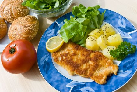 breaded pork chop: breaded pork chop with salad
