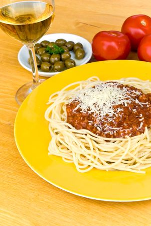 spaghetti bolognese with parmesan cheese and red wine photo