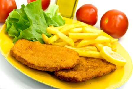 breaded pork chop: breaded cutlet with french fries Stock Photo