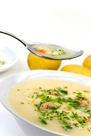 potato cream soup with chopped meat balls photo