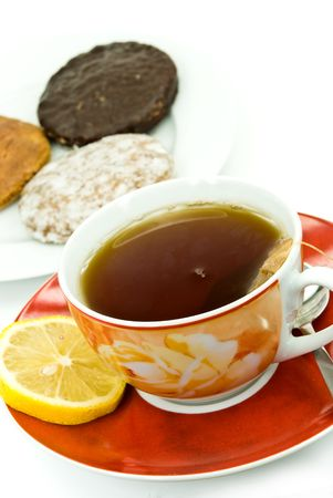 A cup of red tea with mixed cookies photo