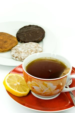 A cup of red tea with mixed cookies Stock Photo - 3532016