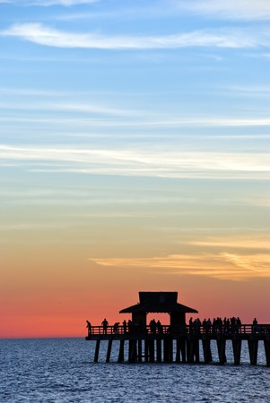 the gulf: Sunset  on the pier in Naples,Florida Stock Photo
