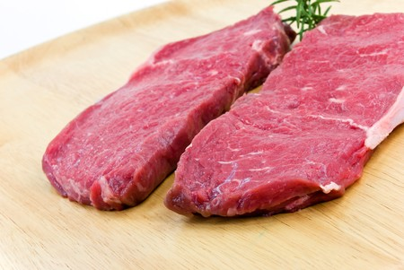 raw beef-,roast beef, meat steak on the wooden background photo