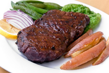 Roast Beef with green Beans and red potatoes photo
