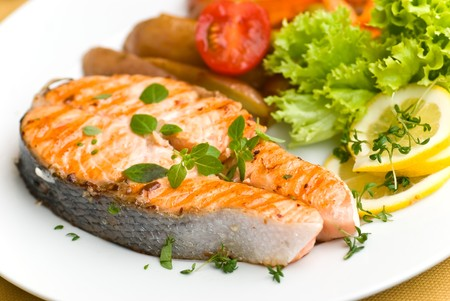 grilled salmon with lettuce and tomato- close up.