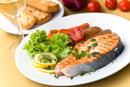 grilled salmon with lettuce and tomato- close up. Stock Photo
