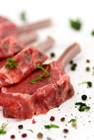 Close up picture of a raw lamb chop  Stock Photo