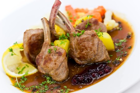 rack of lamb: Close up picture of a roasted lamb chop and vegetables Stock Photo