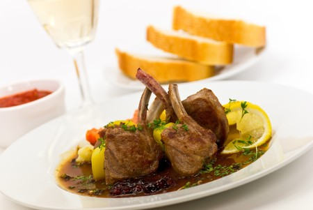 upperdeck view: Close up picture of a roasted lamb chop and vegetables Stock Photo
