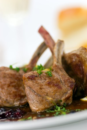 crusted: Close up picture of a roasted lamb chop and vegetables Stock Photo