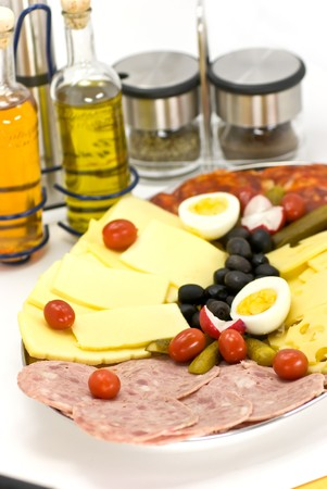 cold cuts- sausage with cheese and boiled eggs photo