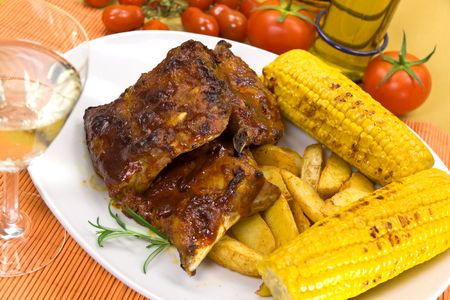 barbecue spare ribs from a grill photo