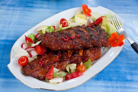 primrose oil: Barbecue spare ribs from a grill with vegetables