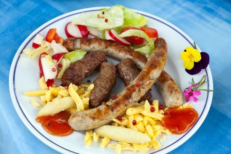 Sausage and minced meat - hamburger with dumplings photo