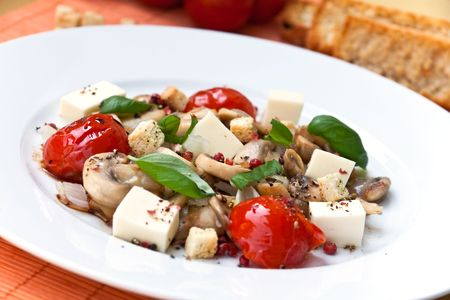Mozzarella with mushrooms cherry tomatoes and mint photo
