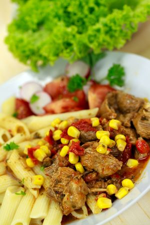 goulash meat with penne noodles photo