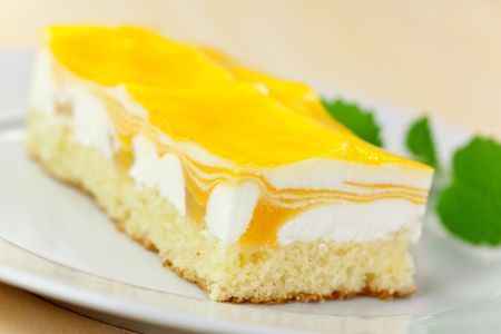 food series: mango fancy cake with yellow fruit jelly photo