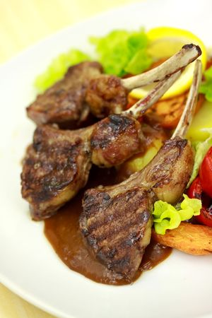 Lamb Rack - grilled,with sauce,peppercorn,baked tomato photo