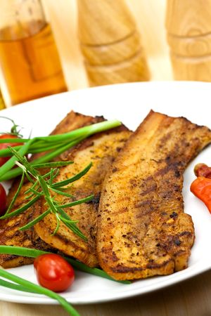british cuisine: Roasted Belly of Pork with cherry tomatoes
