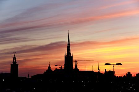 Sunset -  Silhouette of Stockholm, The City Hall, Riddarholm cathedral. Sweden photo
