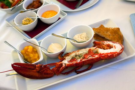 Image of lobsters ,fresh roasted on a grill,with sauce bechamel Stock Photo - 5142944