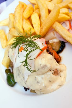 grilled slices of chicken with sauce bearnaise photo
