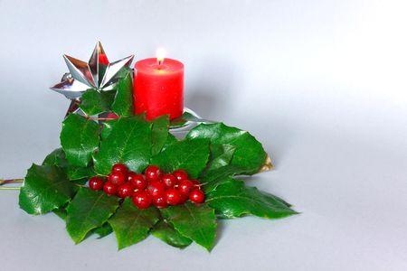 chinese holly: Christmas decoration -  holly with berries ,candle