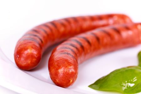 Grilled Sausage on the plate Stock Photo