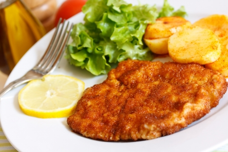 Veal Cutlet- Schnitzel - with Lettuce Stock Photo