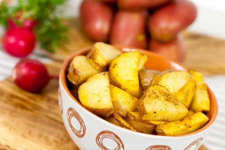 Deep fried potatoes in the bowl photo