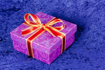 purple gift box,with red ribbon,isolated on white photo