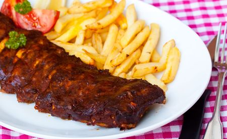 BBQ marinated spareribs and fries photo