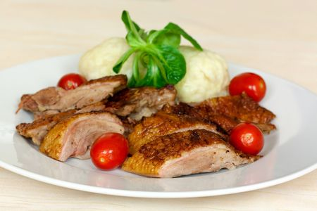 Baked Duck Slices with Dumplings,Cherry Tomatoes,Green Salad photo
