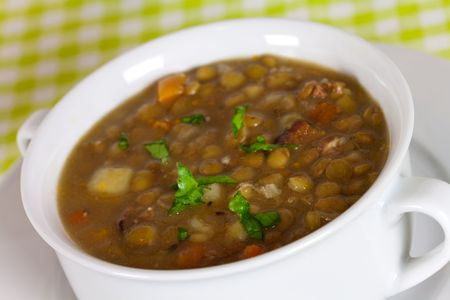 чечевица:  spoonful of lentil stew Фото со стока