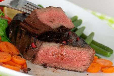 New York Steak- meat on Green Beans,Carrot,Pepper and green salad over plate photo