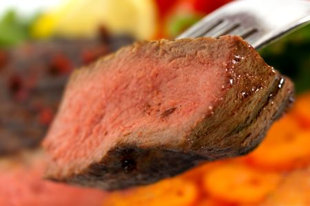 New York Steak- meat on Carrot,Pepper and green salad over plate photo