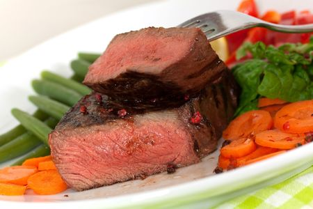 New York Steak- meat on Carrot,Pepper and green salad over plate