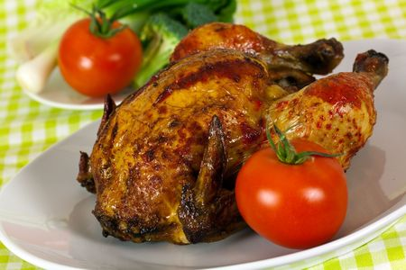 Delicious roasted chicken - delicate art of Portuguese,with crust of ketchup Stock Photo