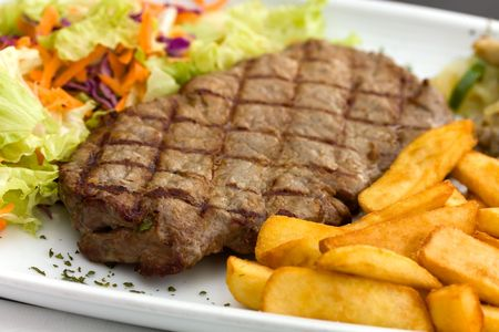 Sirloin steak with chips ,mushrooms,salad photo