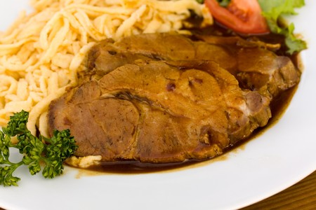 Roast of Pork with Sauce,and spaetzle , type of South German pasta dish photo