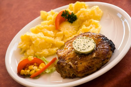 steak of pork,grilled-with salad of potatoes photo