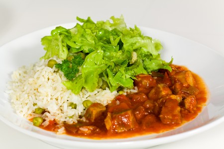 goulash: fresh cooked,stew of beef and pork with rice and salad  Stock Photo