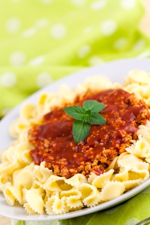plateful: Spaghetti serve on plate with chopped meats