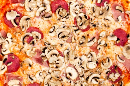 Big Party Pizza salami,mushrooms and vegetable-Shallow depth-of-field  photo