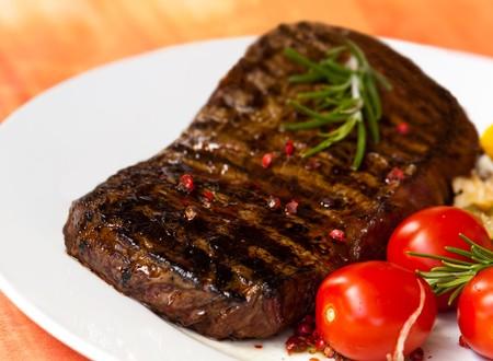 big new york strip steak,grilled,with salad  photo