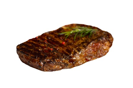 big new york strip steak,grilled,with salad ,isolated on white photo