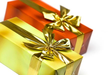 pretty s shiny: Gift box and golden ribbon, isolated on the white background