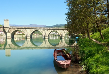 Old,Famous bridge on the Drina in Visegrad, Bosnia and Herzegovina, on a hot summer day.  photo